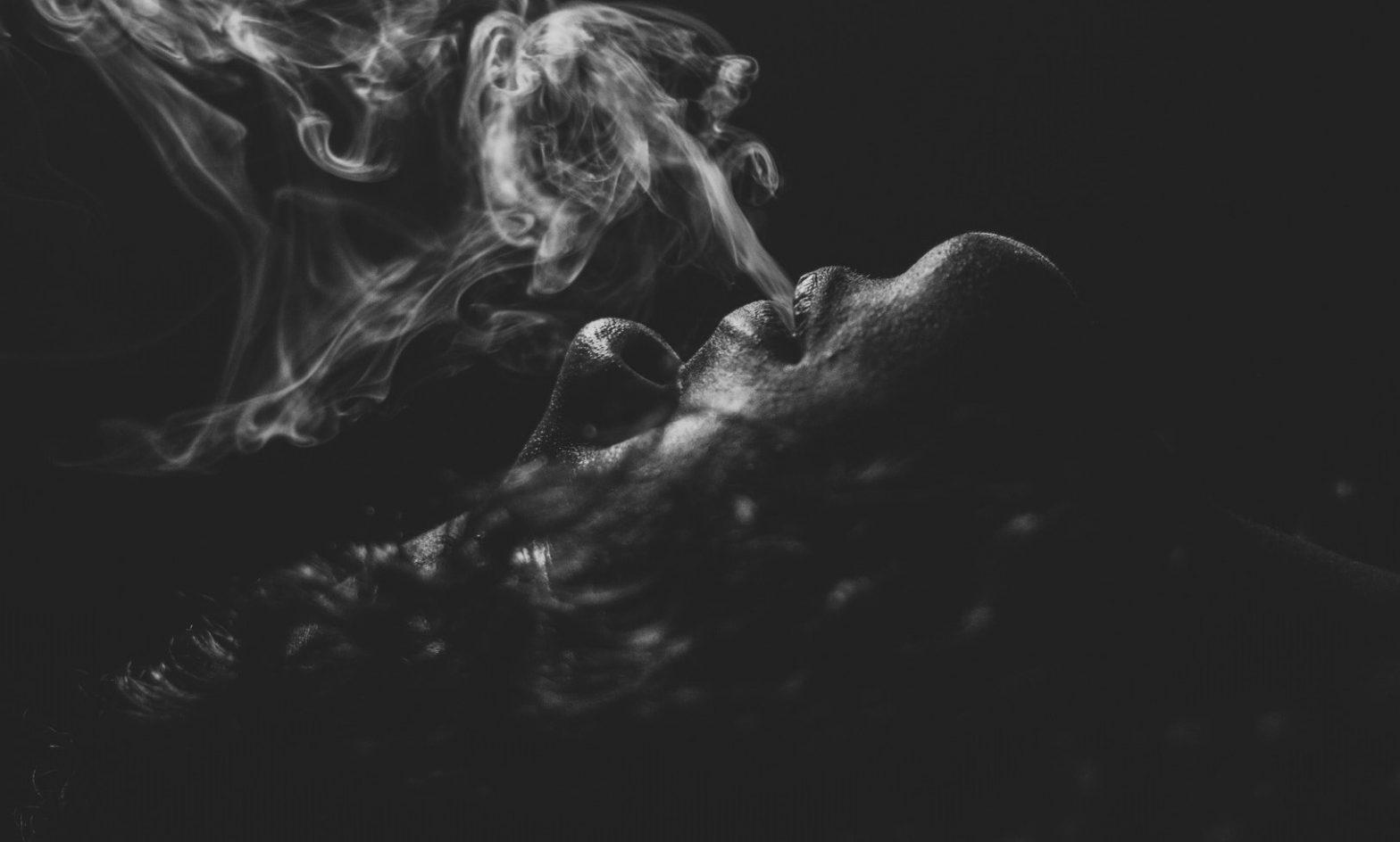 Black and white image of cigar smoking